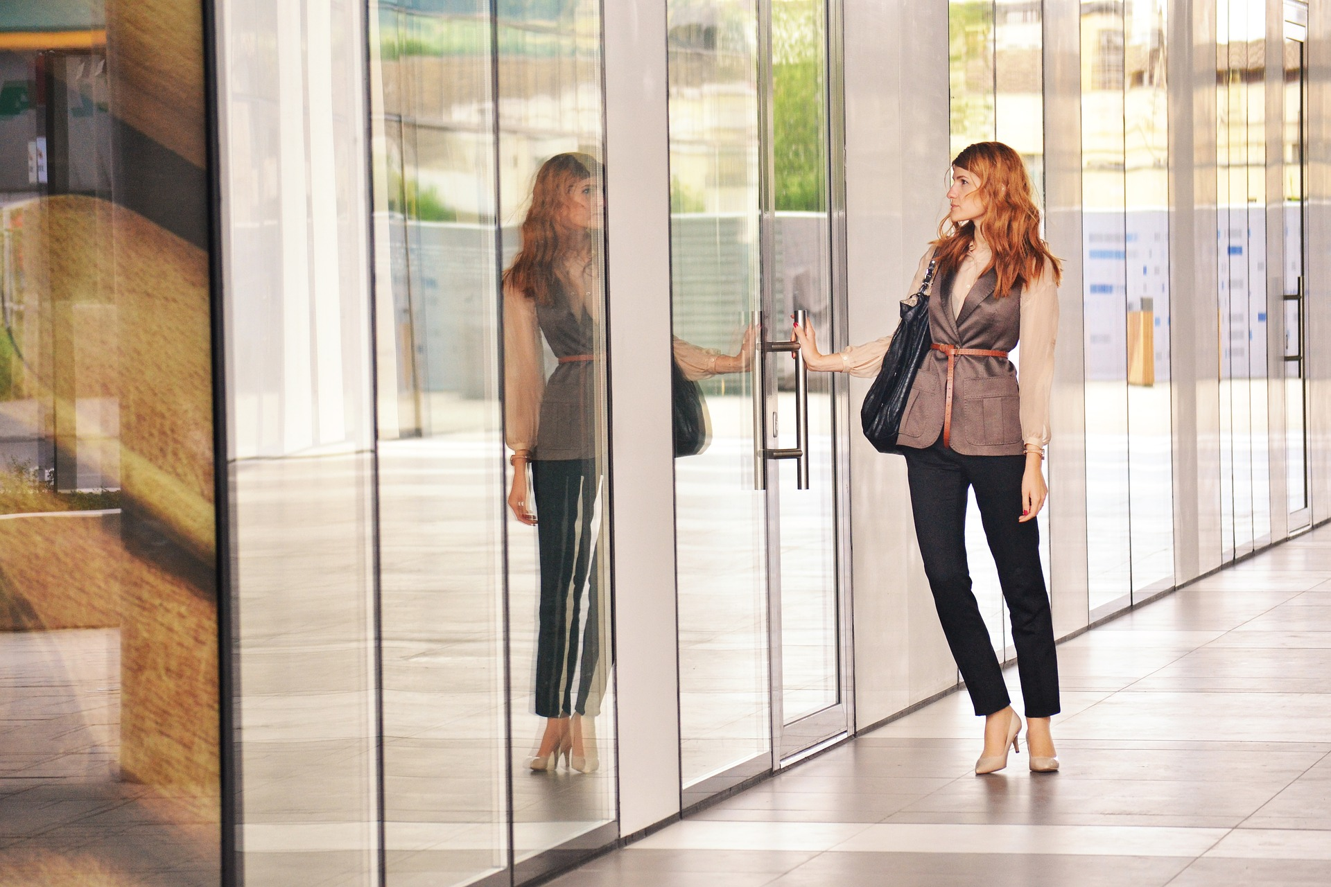 Business woman opening office door
